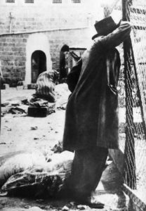 A survivor mourning in the aftermath of the massacre in Hebron.